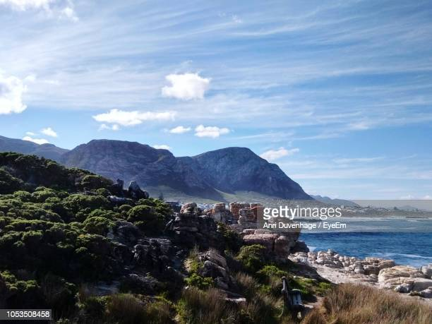 scenic view of sea and mountains against sky - anri stock pictures, royalty-free photos & images