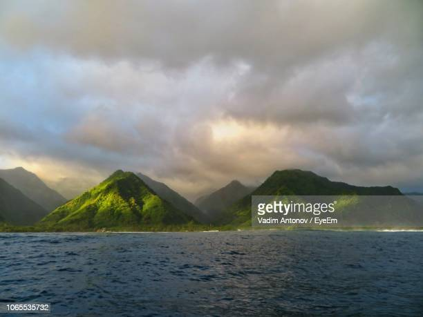 scenic view of sea and mountains against sky - antonov stock pictures, royalty-free photos & images