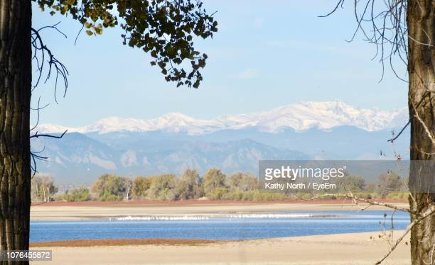 scenic view of sea and mountains against sky - commerce city colorado stock pictures, royalty-free photos & images