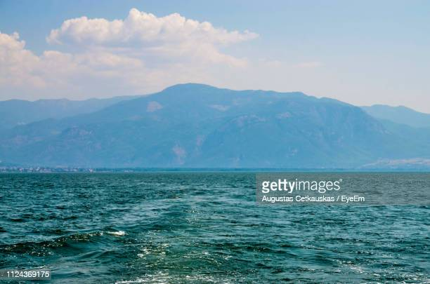scenic view of sea and mountains against sky - cetkauskas stock pictures, royalty-free photos & images