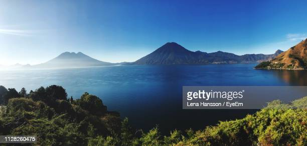 scenic view of sea and mountains against sky - guatemala stock pictures, royalty-free photos & images