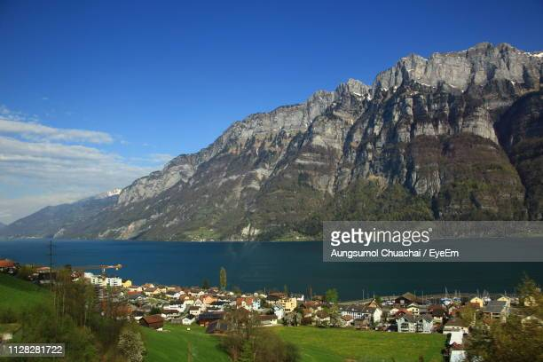 scenic view of sea and mountains against sky - aungsumol stock pictures, royalty-free photos & images