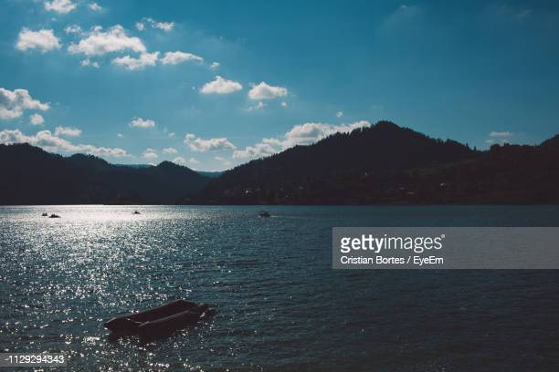 scenic view of sea and mountains against sky - bortes stock pictures, royalty-free photos & images