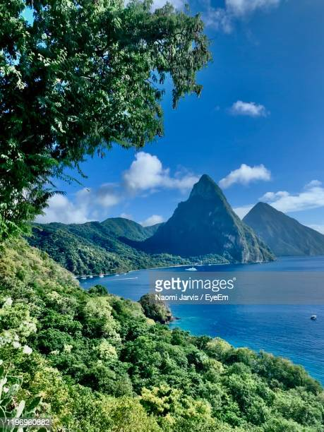 scenic view of sea and mountains against sky - naomi jarvis stock pictures, royalty-free photos & images