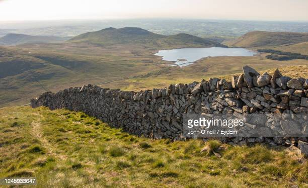 scenic view of sea and mountains against sky - northern ireland stock pictures, royalty-free photos & images