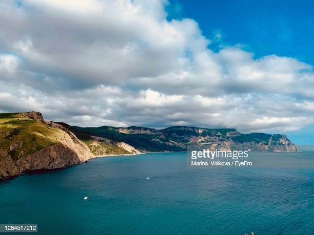 scenic view of sea and mountains against sky - ukraine stock pictures, royalty-free photos & images
