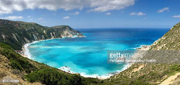 scenic view of sea and mountains against sky - vgenopoulos stock pictures, royalty-free photos & images