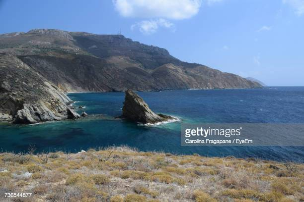 scenic view of sea and mountains against sky - carolina fragapane stock pictures, royalty-free photos & images