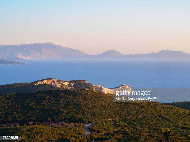 scenic view of sea and mountains against sky - monika gregussova stock pictures, royalty-free photos & images