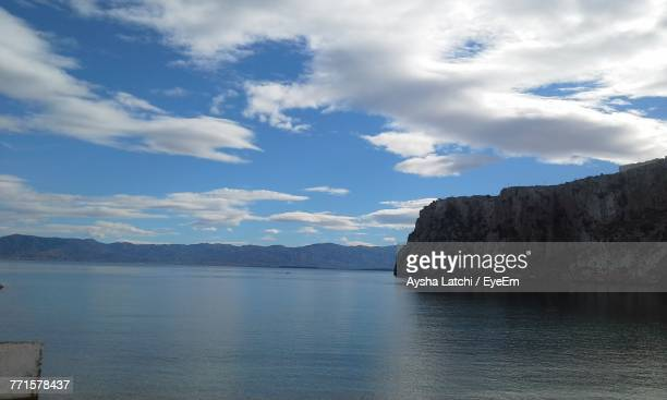 scenic view of sea and mountains against sky - latchi ストックフォトと画像