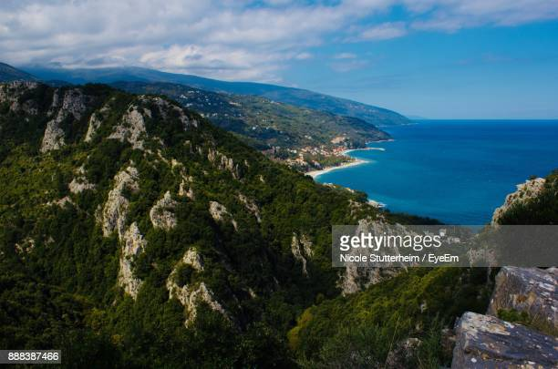 scenic view of sea and mountains against sky - stutterheim stock photos and pictures