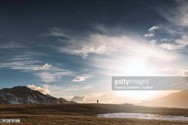 scenic view of sea and mountains against sky - fabrizio zampetti foto e immagini stock