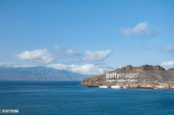 scenic view of sea and mountains against sky - angela rohde stock-fotos und bilder