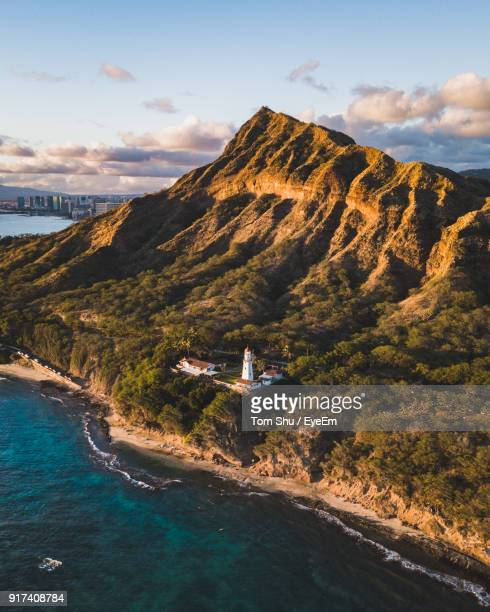 scenic view of sea and mountains against sky - diamond head stock photos and pictures