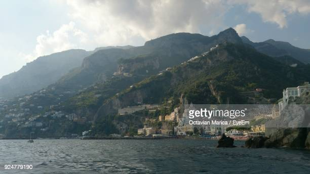 scenic view of sea and mountains against sky - marica octavian stock photos and pictures
