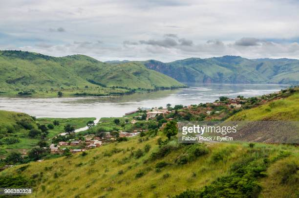 scenic view of sea and mountains against sky - democratic republic of the congo ストックフォトと画像