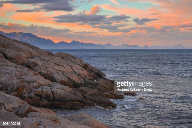 scenic view of sea and mountains during sunset - eriksen foto e immagini stock