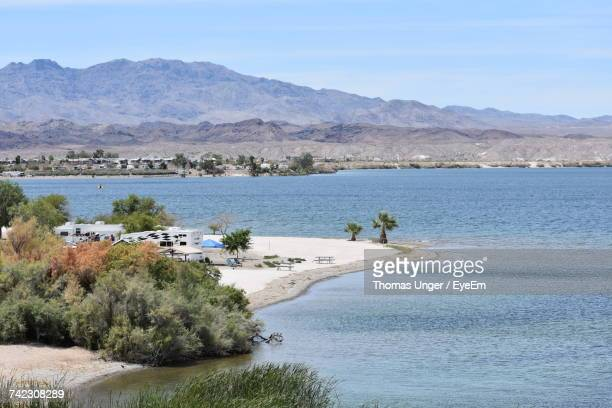 scenic view of sea and mountains - lake havasu stock photos and pictures
