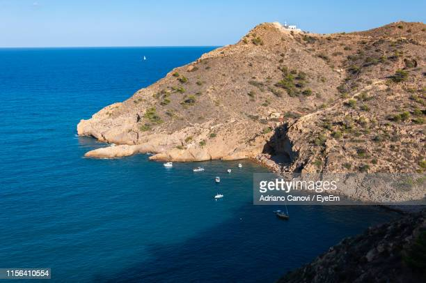 scenic view of sea and rocks against sky - altea photos et images de collection