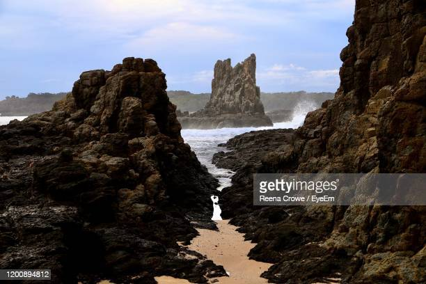 scenic view of sea and rocks against sky - wollongong stock pictures, royalty-free photos & images
