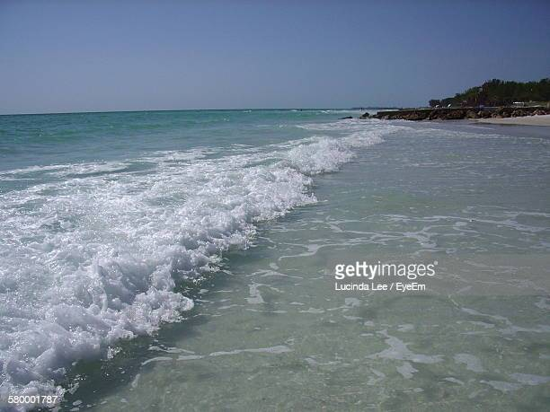 scenic view of sea and shore against sky - lucinda lee stock photos and pictures