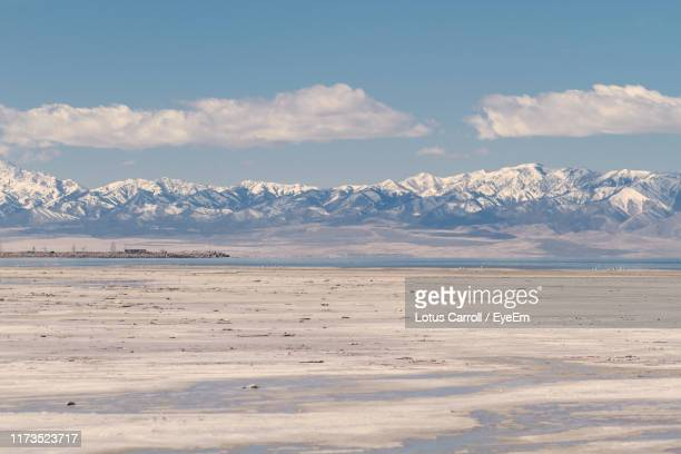 scenic view of sea and snowcapped mountains against sky - great salt lake stock pictures, royalty-free photos & images