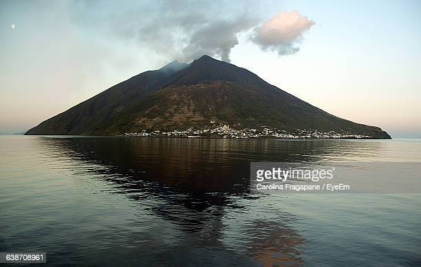 scenic view of sea and stromboli - carolina fragapane stock pictures, royalty-free photos & images