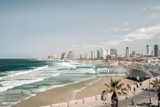 scenic view of sea and tel aviv cityscape against clear sky - tel aviv foto e immagini stock