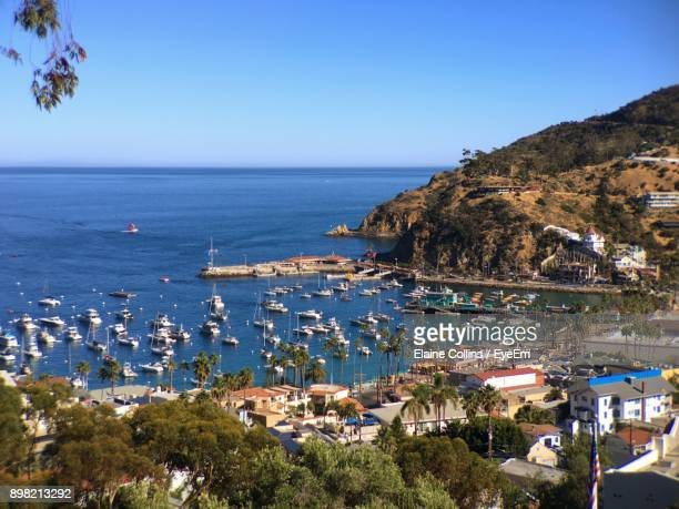 Scenic View Of Sea And Town Against Clear Blue Sky