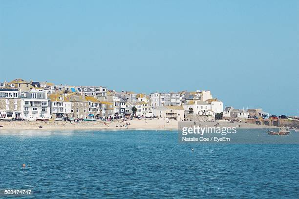 scenic view of sea and townscape against clear blue sky - penzance stock pictures, royalty-free photos & images