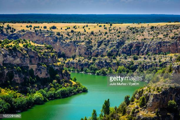 scenic view of sea and trees against sky - segovia stock pictures, royalty-free photos & images
