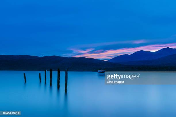 scenic view of sea at dusk, new zealand - image stock pictures, royalty-free photos & images