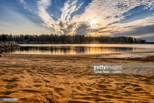 scenic view of sea at sunset - norrbotten province stock pictures, royalty-free photos & images