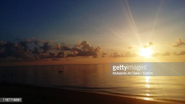 scenic view of sea at sunset - saka stock pictures, royalty-free photos & images