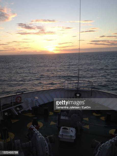 scenic view of sea at sunset - passenger craft stock pictures, royalty-free photos & images
