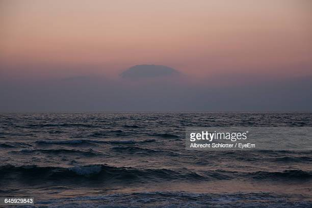 scenic view of sea at sunset - albrecht schlotter stock photos and pictures