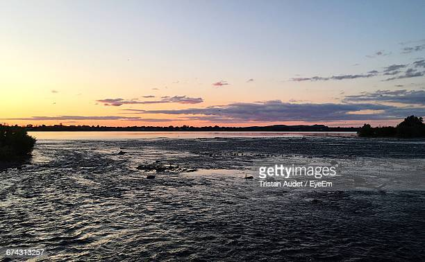 scenic view of sea at sunset - water's edge stock pictures, royalty-free photos & images