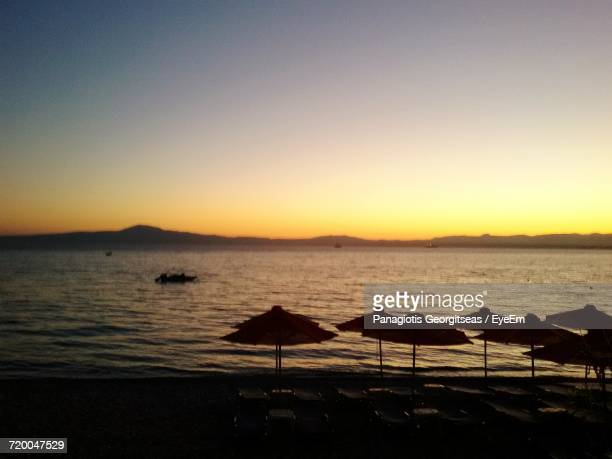 scenic view of sea at sunset - peloponnese stock photos and pictures