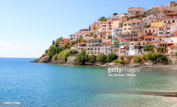 scenic view of sea by buildings against clear sky, kavla, greece - greece stock pictures, royalty-free photos & images