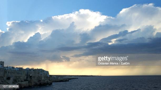scenic view of sea by buildings against sky - marica octavian stock photos and pictures