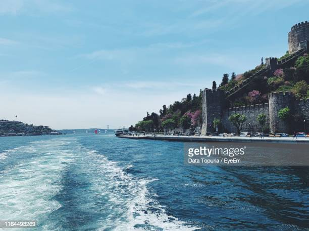 scenic view of sea by buildings against sky - data topuria stock pictures, royalty-free photos & images