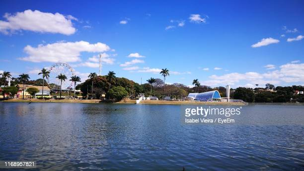 scenic view of sea by buildings against sky - belo horizonte stock pictures, royalty-free photos & images