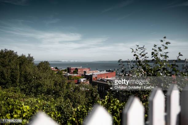 scenic view of sea by buildings against sky - christian soldatke stock pictures, royalty-free photos & images