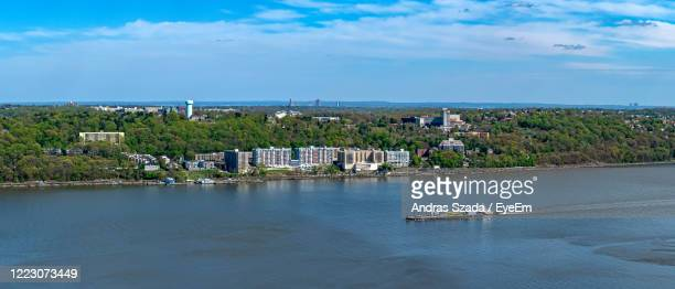 scenic view of sea by buildings against sky - yonkers stock pictures, royalty-free photos & images