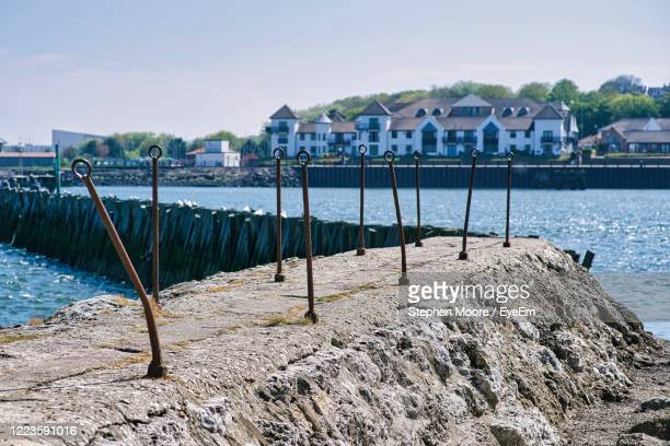 scenic view of sea by buildings against sky - sunderland stock pictures, royalty-free photos & images