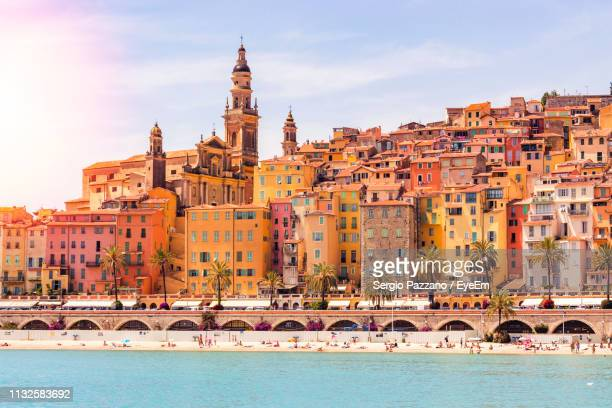 scenic view of sea by buildings in city - french riviera stock pictures, royalty-free photos & images