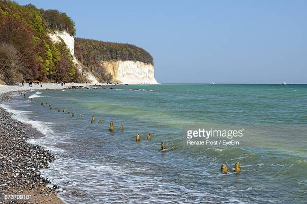 Scenic View Of Sea By Chalk Cliff Against Clear Sky