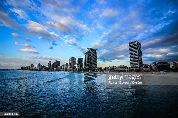 scenic view of sea by city against sky - tel aviv stock pictures, royalty-free photos & images