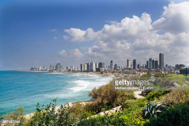 scenic view of sea by cityscape against sky - tel aviv foto e immagini stock