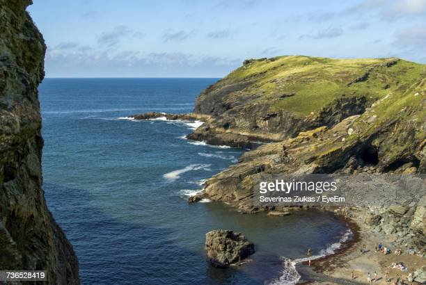 scenic view of sea by cliff against sky - plymouth stock photos and pictures